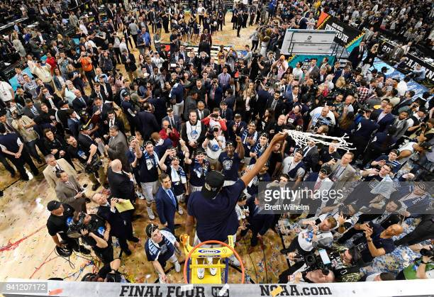 Mikal Bridges of the Villanova Wildcats celebrates with the net after the 2018 NCAA Photos via Getty Images Men's Final Four National Championship...