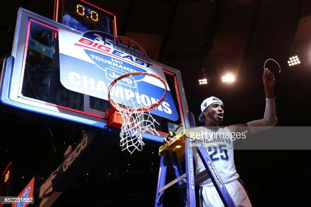 Mikal Bridges of the Villanova Wildcats cuts a piece of the net after defeating the Creighton Bluejays to win the Big East Basketball Tournament -...