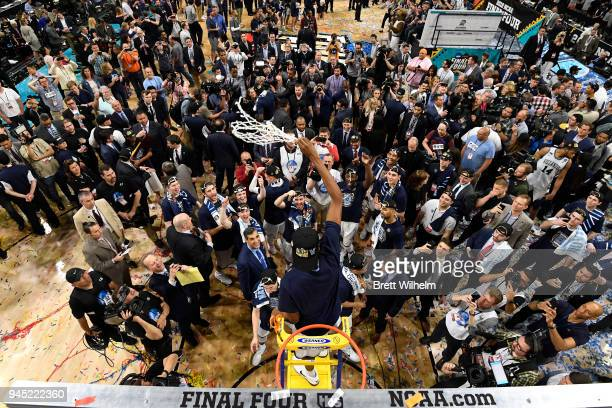 Mikal Bridges of the Villanova Wildcats cuts down the net after defeating the Michigan Wolverines during the 2018 NCAA Men's Final Four Championship...