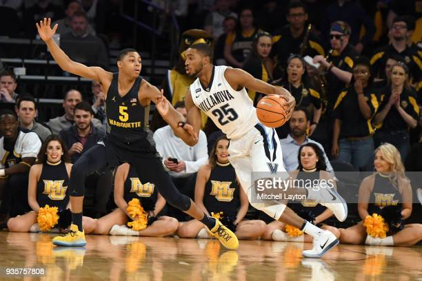 Mikal Bridges of the Villanova Wildcats dribbles around Greg Elliott of the Marquette Golden Eagles during the quarterfinal round the Big East Men's...
