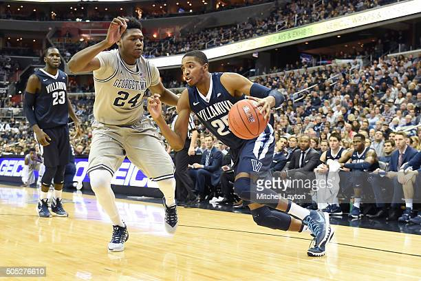 Mikal Bridges of the Villanova Wildcats dribbles around Marcus Derrickson of the Georgetown Hoyas during a college basketball game at the Verizon...