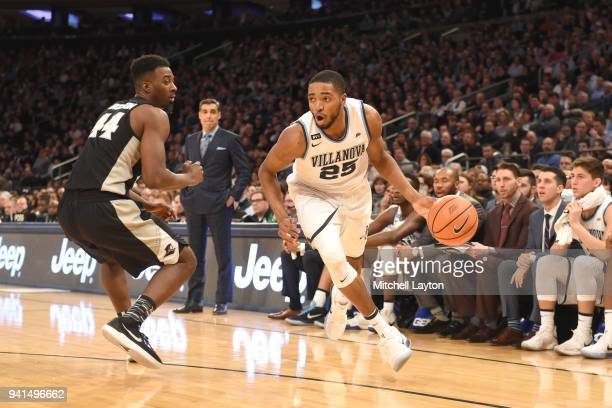 Mikal Bridges of the Villanova Wildcats dribbles the ball by Isaiah Jackson of the Providence Friars during the finals of the 2018 Big East Mens...