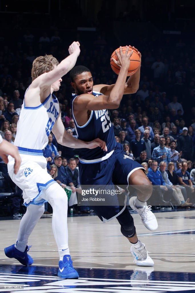 Mikal Bridges #25 of the Villanova Wildcats drives to the basket against J.P. Macura #55 of the Xavier Musketeers in the second half of a game at Cintas Center on February 17, 2018 in Cincinnati, Ohio. Villanova won 95-79.