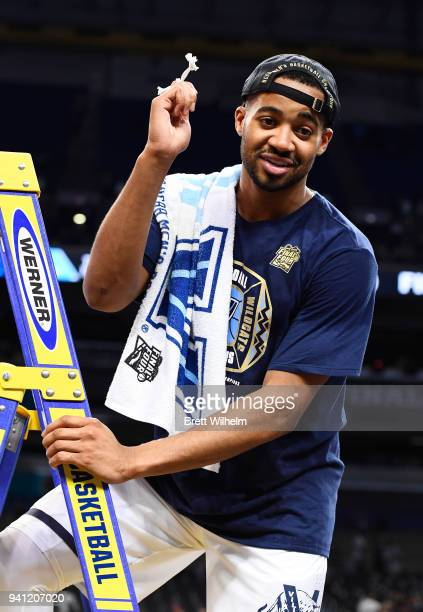 Mikal Bridges of the Villanova Wildcats holds a piece of the net after the 2018 NCAA Photos via Getty Images Men's Final Four National Championship...