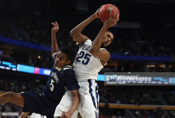 Mikal Bridges of the Villanova Wildcats rebounds against Chris Wray of the Mount St Mary's Mountaineers in the second half during the first round of...