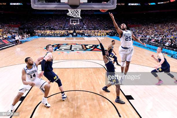 Mikal Bridges of the Villanova Wildcats shoots against Zavier Simpson of the Michigan Wolverines in the second half during the 2018 NCAA Men's Final...