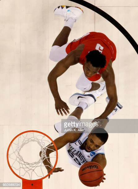 Mikal Bridges of the Villanova Wildcats shoots the ball against Donald Hicks of the Radford Highlanders in the game in the first round of the 2018...