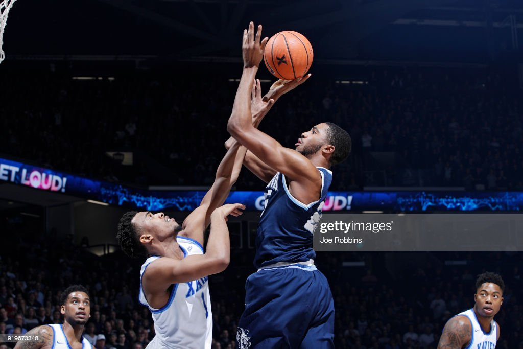 Mikal Bridges #25 of the Villanova Wildcats shoots the ball against Paul Scruggs #1 of the Xavier Musketeers in the second half of a game at Cintas Center on February 17, 2018 in Cincinnati, Ohio. Villanova won 95-79.