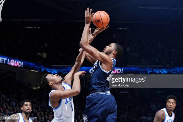 Mikal Bridges of the Villanova Wildcats shoots the ball against Paul Scruggs of the Xavier Musketeers in the second half of a game at Cintas Center...