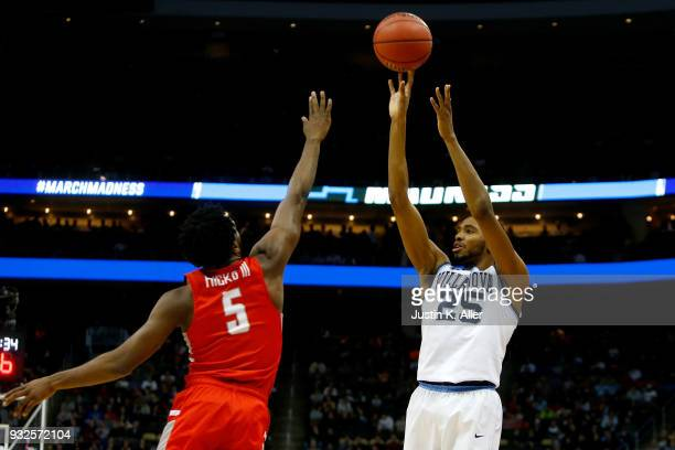 Mikal Bridges of the Villanova Wildcats takes a shot against Donald Hicks of the Radford Highlanders during the first half of the game in the first...