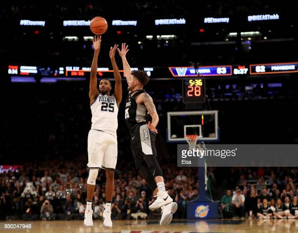 Mikal Bridges of the Villanova Wildcats takes a shot as Drew Edwards of the Providence Friars defends during the championship game of the Big East...