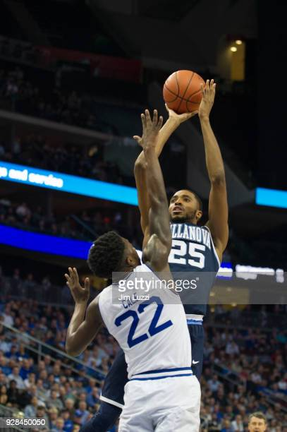 Mikal Bridges of The Villanova Wildcats takes a shot as Myles Cale of The Seton Hall Pirates defends on February 28 2018 at Prudential Center in...