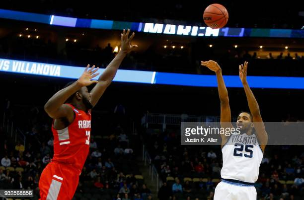 Mikal Bridges of the Villanova Wildcats takes a shot on Randy Phillips of the Radford Highlanders during the first half of the game in the first...