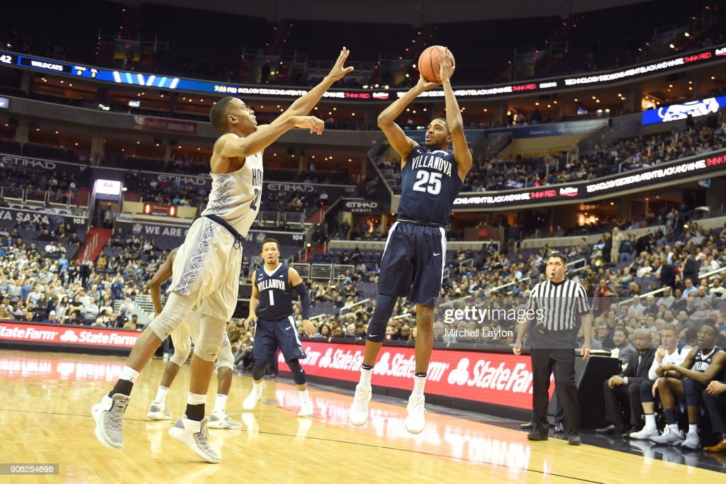Mikal Bridges #25 of the Villanova Wildcats takes a shot over Kaleb Johnson #32 of the Georgetown Hoyas during a college basketball game at the Capital One Arena on January 17, 2018 in Washington, DC.