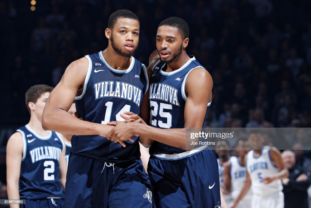Mikal Bridges #25 of the Villanova Wildcats tries to calm down Omari Spellman #14 after a scuffle against the Xavier Musketeers in the second half of a game at Cintas Center on February 17, 2018 in Cincinnati, Ohio. Villanova won 95-79.