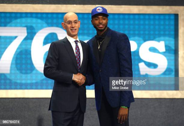 Mikal Bridges poses with NBA Commissioner Adam Silver after being drafted tenth overall by the Philadelphia 76ers during the 2018 NBA Draft at the...