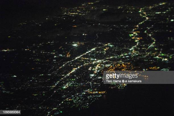 Mikawa Bay and Handa city in Aichi prefecture in Japan night time aerial view from airplane