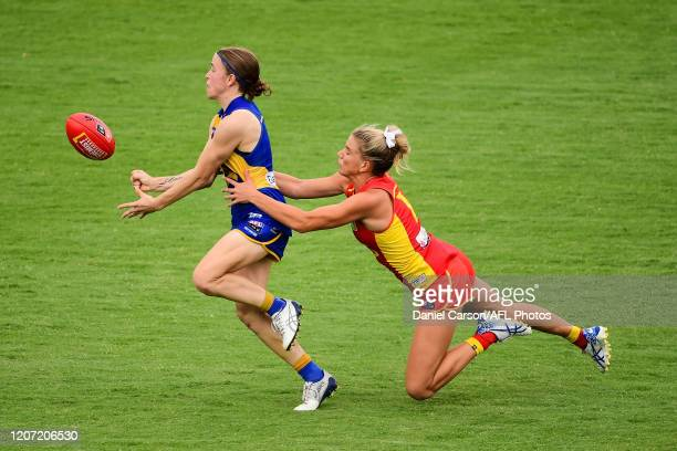 Mikayla Bowen of the Eagles is tackled by Paige Parker of the Suns during the 2020 AFLW Round 06 match between the West Coast Eagles and the Gold...