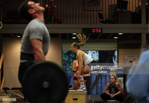 Mikayla Jones does a box jump during a CrossFit workout at Ross Valley CrossFit on March 13 2014 in San Anselmo California CrossFit a high intensity...