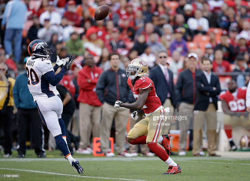 Mike Adams #20 of the Denver Broncos intercepts a pass intended for A.J. Jenkins #17 of the San Francisco 49ers during their preseason NFL game at Candlestick Park on August 8, 2013 in San Francisco, California.