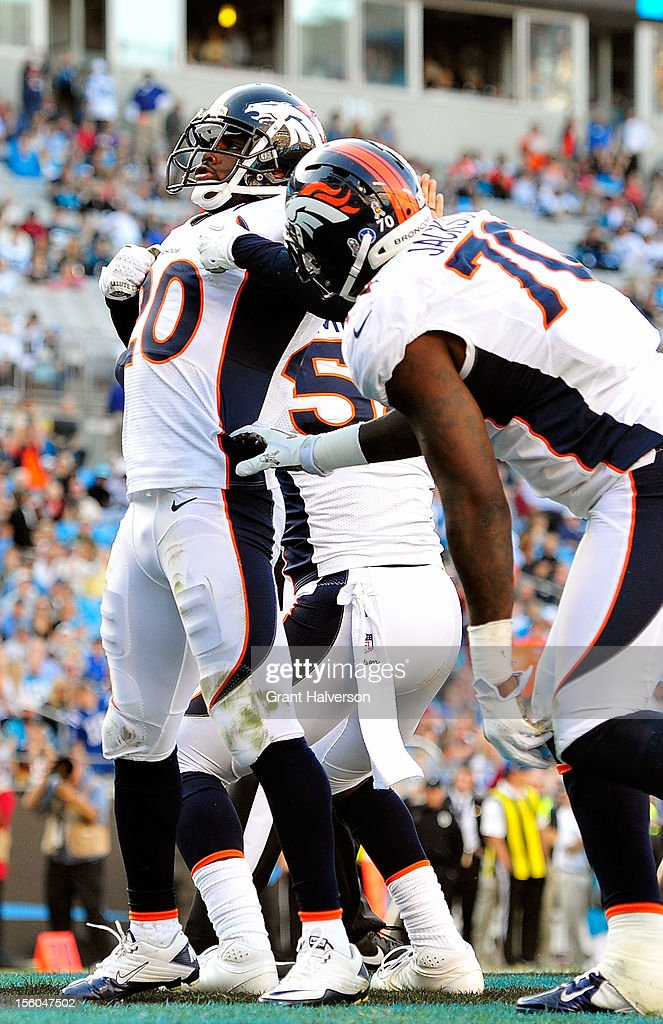 Mike Adams #20 of the Denver Broncos mocks the 'Superman' celebration of quarterback Cam Newton of the Carolina Panthers after sacking Newton for a safety during play at Bank of America Stadium on November 11, 2012 in Charlotte, North Carolina. The Broncos won 36-14.