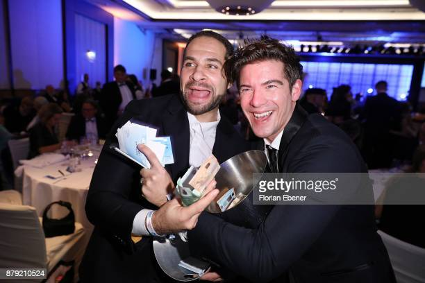 Mike Adler and Philipp Danne attend the charity event Dolphin's Night at InterContinental Hotel on November 25 2017 in Duesseldorf Germany
