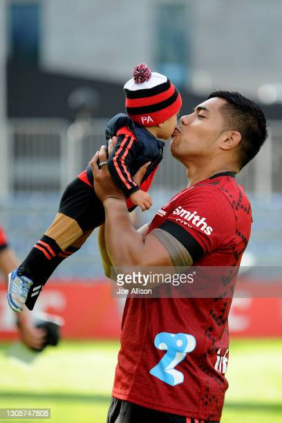 Mike Alaalatoa of the Crusaders gives his son a kiss during the round two Super Rugby Aotearoa match between the Crusaders and the Hurricanes at...