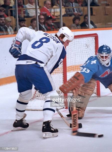 Mike Allison of the Toronto Maple Leafs skates against Mario Gosselin of the Quebec Nordique during NHL preseason game action on September 30 1987 at...