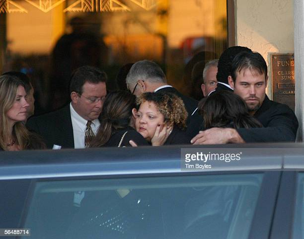 Mike Alstott a former player for Indianapolis Colts Head Coach Tony Dungy hugs a supporter during a wake for Dungy's son James at Wilson Funeral Home...