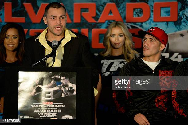 Mike Alvarado addresses the media as Brandon Rios looks on during a press conference January 22, 2015 for the upcoming WBO International Welterweight...