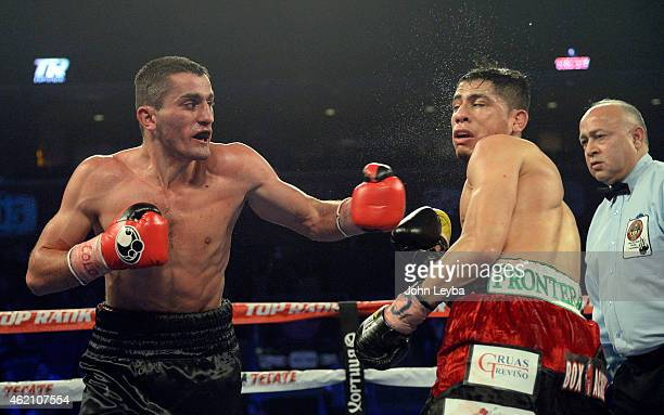 Mike Alvarado and Brandon Rios battle during the WBO International Welterweight Title fight January 24, 2015 at 1st Bank Arena.