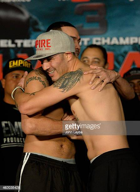 Mike Alvarado and Brandon Rios hug after their weigh in January 23, 2015 at the Tailgate Roadhouse for the upcoming WBO International Welterweight...