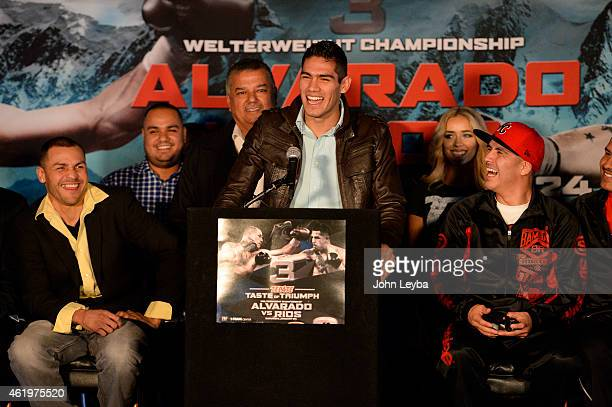 Mike Alvarado and Brandon Rios laugh as Light Heavyweight Gilberto Ramirez takes to the microphone and addresses the media in english during a press...