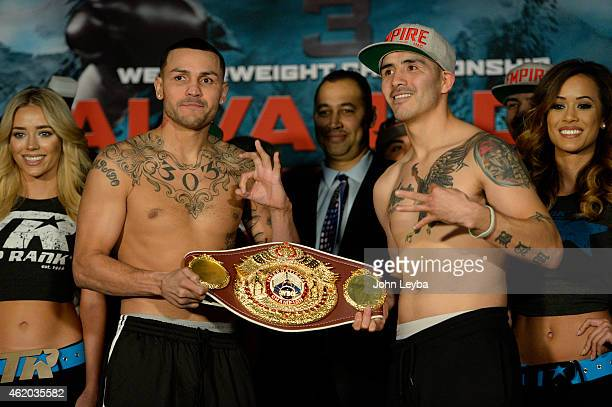 Mike Alvarado and Brandon Rios pose for photos after their weigh in January 23, 2015 at the Tailgate Roadhouse for the upcoming WBO International...