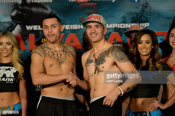 Mike Alvarado and Brandon Rios shake hands after their weigh in January 23, 2015 at the Tailgate Roadhouse for the upcoming WBO International...