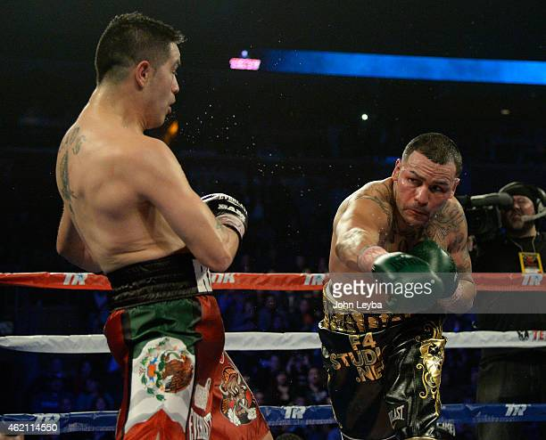 Mike Alvarado misses on a punch as Brandon Rios backs up during the WBO International Welterweight Title fight January 24, 2015 at 1st Bank Arena.