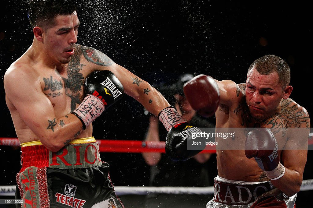 Mike Alvarado throws a right to the head of Brandon Rios in their WBO interim junior welterweight championship bout at the Mandalay Bay Events Center on March 30, 2013 in Las Vegas, Nevada.