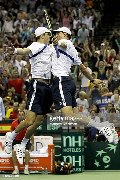Mike and Bob Bryan celebrate match point against Fernando Verdasco and Marcel Granollers of Spain during the third rubber of the Davis Cup tie...