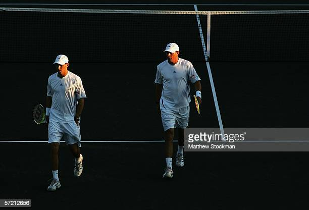 Mike and Bob Bryan confer between points during the men's doubles quarterfinals match against Chris Haggard and Wesley Moodie of South Africa at the...