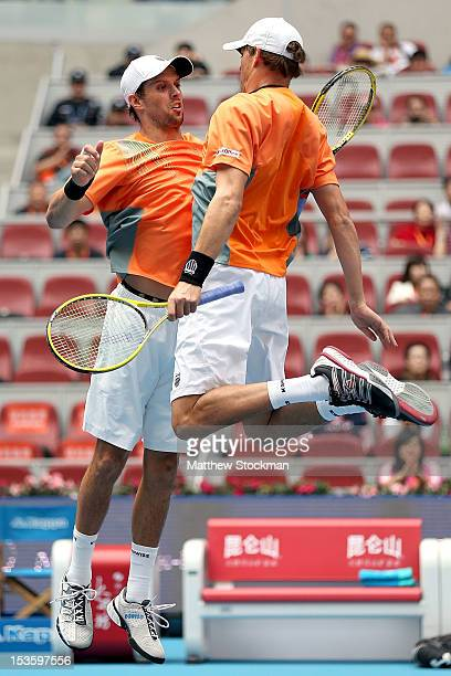 Mike and Bob Bryan of the United States celebrate match point against Carlos Berlocq of Argentina and Denis Istomin of Uzbekistan during the doubles...