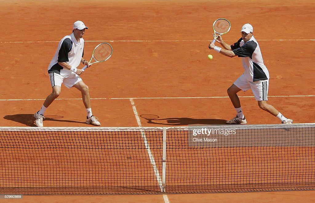 Mike (L) and Bob Bryan of USA in action during their second round doubles match against Rainer Schuettler of Germany and Mikhail Youzhny of Russia during the sixth day of the French Open at Roland Garros on May 28, 2005 in Paris, France.