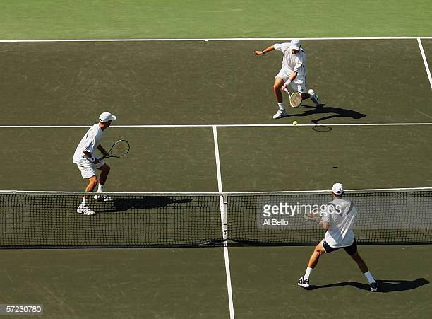 Mike and Bob Bryan return a shot to Jonas Bjorkman of Sweden and Max Mirnyi of Belarus in the men's doubles final at the Nasdaq100 Open at the Tennis...