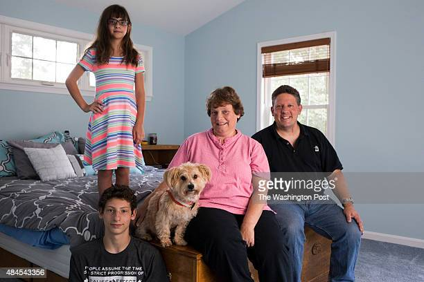 Mike and Cherie Jacobs, who have recently renovated their 40-year old home, pose for a portrait with their children Ginny and Daniel 16, and dog...