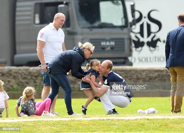 Mike and Zara Tindall watches daughter Mia get a hug from Prince William Duke of Cambridge at the Maserati Royal Charity Polo Trophy at Beaufort Polo...