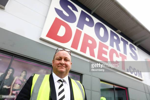 Mike Ashley billionaire and founder of Sports Direct International Plc poses for photographer at his company's warehouse following the company's...