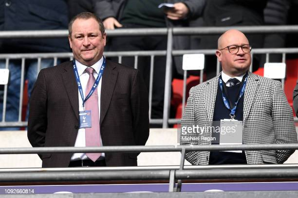 Mike Ashley Newcastle United owner and Lee Charnley look on prior to the Premier League match between Tottenham Hotspur and Newcastle United at...
