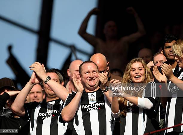 Mike Ashley owner of Newcastle United celebrates the first goal during the Barclays Premier League match between Aston Villa and Newcastle United at...