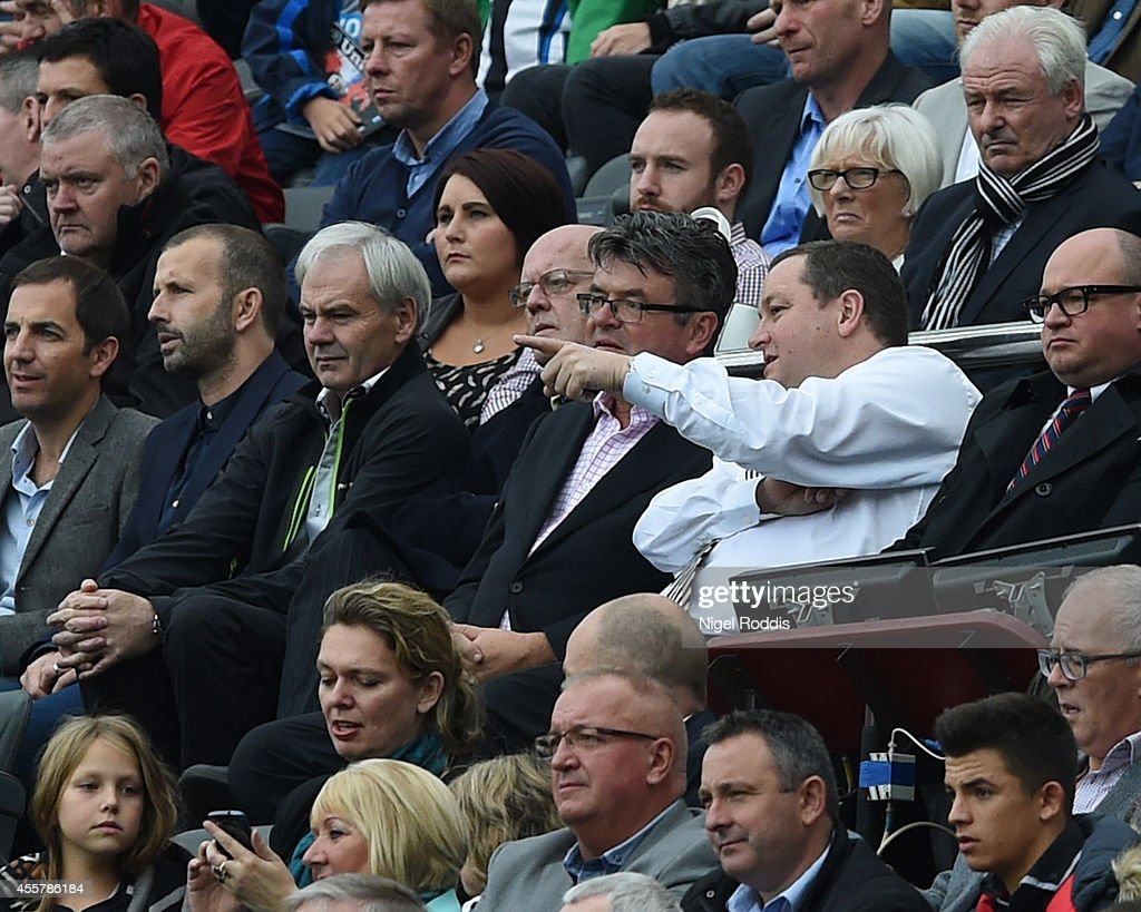 Mike Ashley owner of Newcastle United points during Premier League Football match between Newcastle United and Hull City at St James' Park on September 20, 2014 in Newcastle upon Tyne, England.