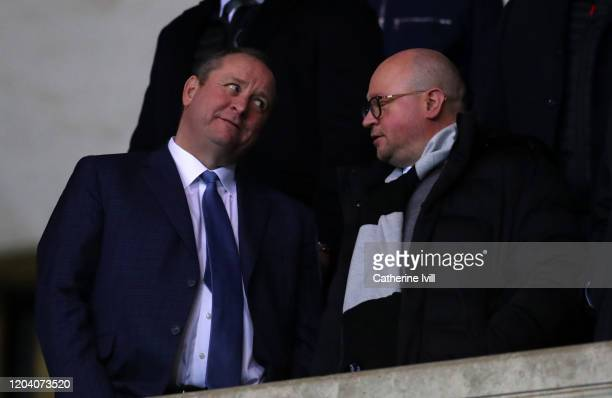 Mike Ashley owner of Newcastle United talks to managing Directory Lee Charnley ahead of the FA Cup Fourth Round Replay match between Oxford United...