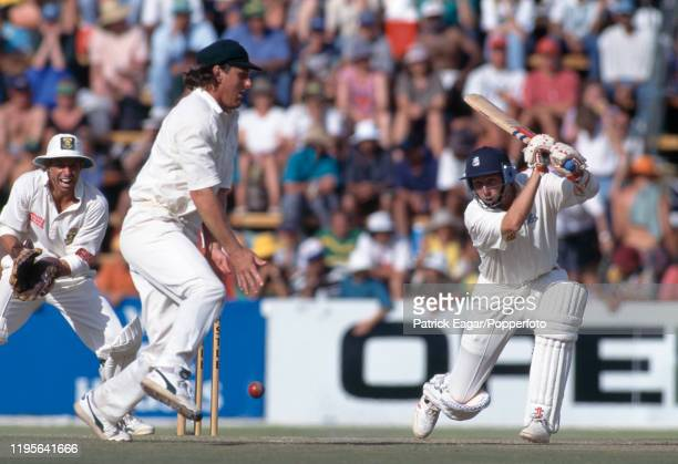 Mike Atherton of England drives the ball past Brian McMillan of South Africa during his innings of 185 not out in the 2nd Test match between South...